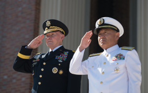 Eighteenth Chairman of the Joint Chiefs of Staff Gen. Martin E. Dempsey and his Japanese counterpart Adm. Katsutoshi Kawano render honors during the playing of the their respective national anthems during a Defense Chiefs Strategy Dialogue at Roosevelt Hall on Fort Lesley J. McNair in Washington, July 16, 2015. (DoD photo by Mass Communication Specialist 1st Class Daniel Hinton/released)